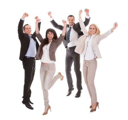 businessman jumping: Portrait Of Happy Successful Business Group Over White Background Stock Photo