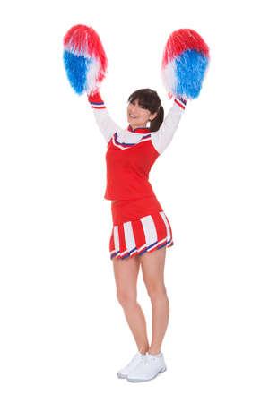 adult cheerleader: Happy Cheerleader Holding Pom-pom Over White Background