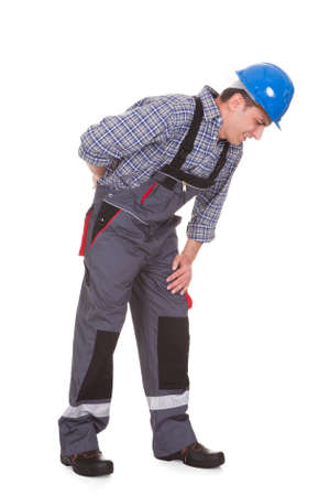 knee bend: Male Worker Suffering With Pain Over White Background