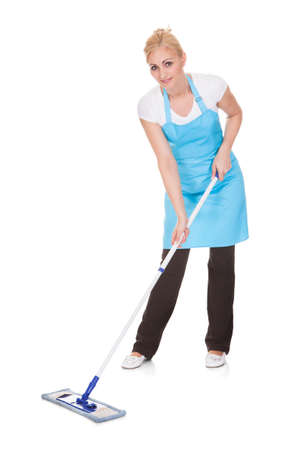 Happy Woman Holding Broom Over White Background photo