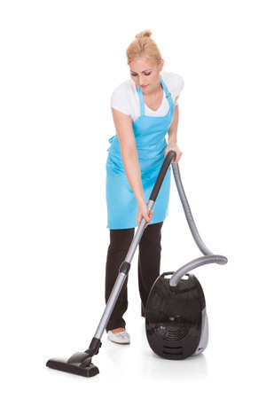 vacuum: Happy Woman Holding Vacuum Cleaner Over White Background