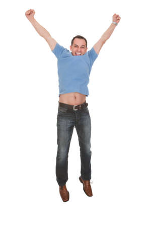 leaping: Happy Man With Arm Raised Over White Background Stock Photo