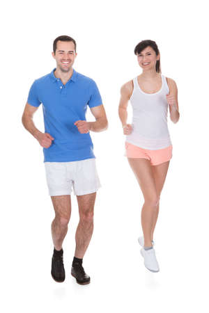 Happy Young Couple Jogging Over White Background