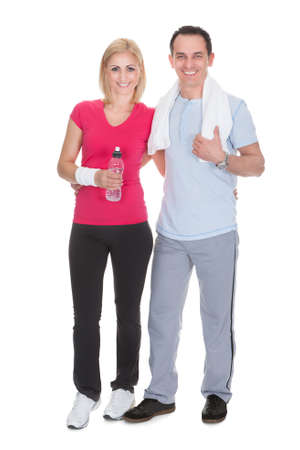 Happy Couple Working Out Over White Background photo