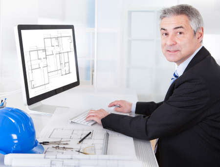 Portrait Of Mature Architect Male With Blueprint In The Office Stock Photo - 20201066