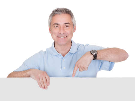 Man Presenting Blank Placard Over White Background photo