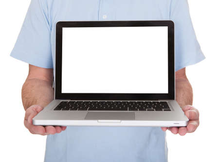 Mature Man Holding Laptop Over White Background photo