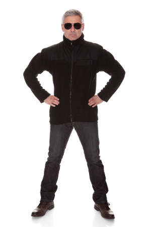 federal police: Mature security man standing over white background