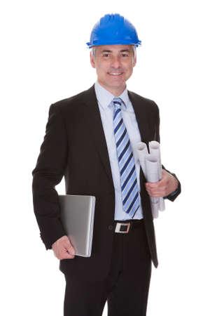 Portrait Of Happy Mature Architect Isolated Over White Background photo