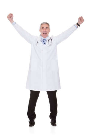 modern doctor: Portrait Of Excited Male  Doctor Isolated Over White Background