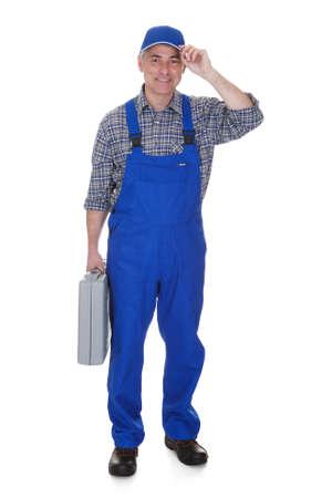 plumbing repair: Mature Male Technician Holding Worktool Over White Background