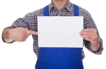 Mature Male Technician Holding Empty Sheet Over White Background photo