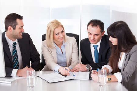 Happy Business Team In Office At The Meeting Stock Photo - 20505039