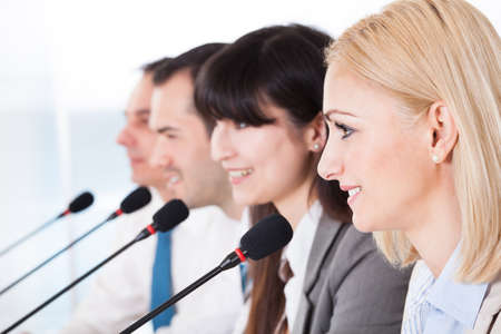 Business People Speaking In Microphone In Office Stock Photo - 20505000