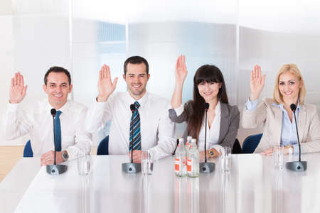 Group Of Business People In Conference Raising Hands Stock Photo - 20504931