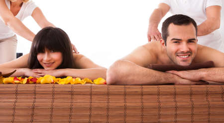 Beautiful Young Couple Enjoying Massage In Spa Centre photo