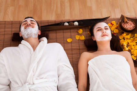 Couple With Face Mask In Spa Centre photo