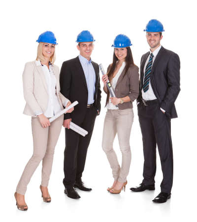 Group Of Happy Architect Standing Over White Background Stock Photo - 20504794
