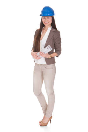 Happy Female Architect Standing Over White Background Stock Photo - 20504598