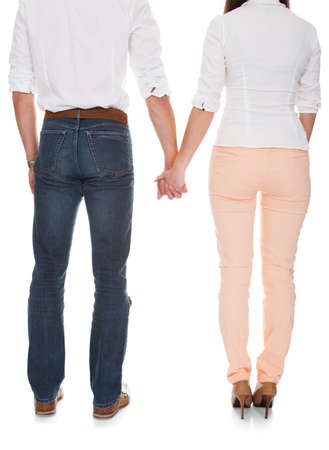 couple holding hands: Young Couple Holding Hands Over White Background