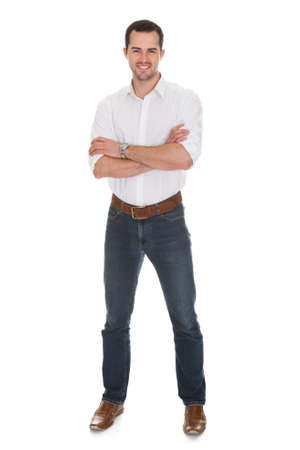 man standing alone: Portrait of smiling young man. Isolated on white