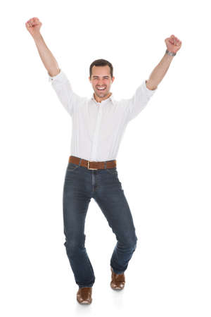 cheer: Happy Man With Arm Raised Over White Background Stock Photo