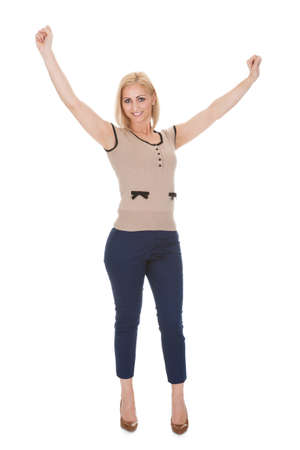Happy Man With Arm Raised Over White Background Stock Photo - 20504718