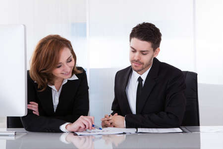 Business partners discussing together in office at meeting photo