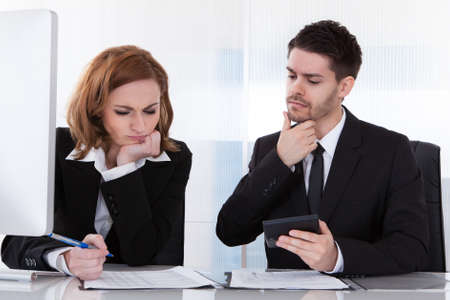 Portrait of two business colleagues at office working together photo