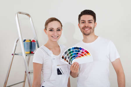 Portrait Of Happy Young Couple With Color Samples photo