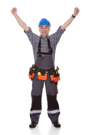 jumpsuit: Portrait Of Happy Repairman Over White Background