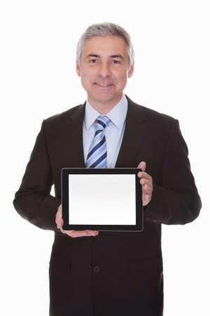 one senior adult man: Mature Businessman Showing Digital Tablet Over White Background