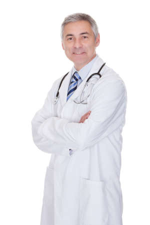 male doctor: Portrait Of Happy Mature Male Doctor Isolated Over White Background Stock Photo