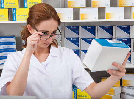 Female Pharmacist Chemist Working In The Pharmacy photo