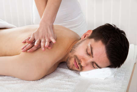 adult massage: Man getting massage in the spa centre