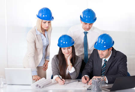 executive helmet: Group Of Architect People Working On Project Stock Photo