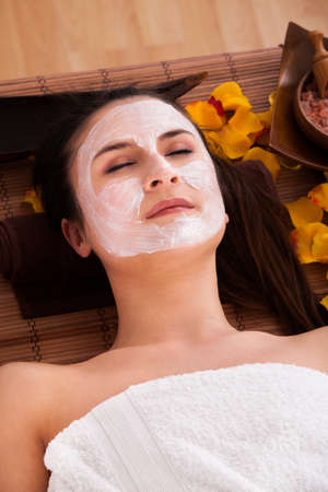 Woman With Face Mask In Spa Centre photo
