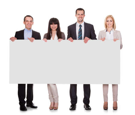 Portrait Of Happy Businesspeople Group Holding Placard Over White Background photo