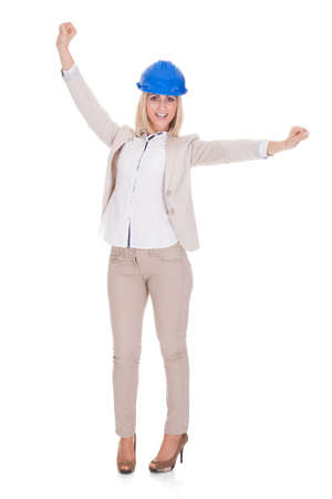 Excited Female Architect With Arms Raised Over White Background Stock Photo - 20508761