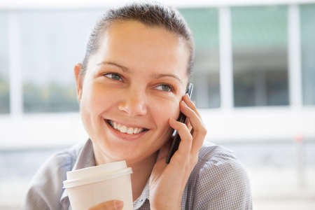 Portrait of young happy woman talking on cell phone; outdoors Stock Photo - 20535352