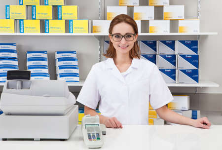 Portrait Of Happy Female Pharmacist In Pharmacy photo