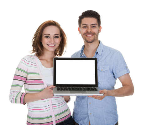 laptop keyboard: Young Happy Couple Holding Laptop Isolated Over White Background