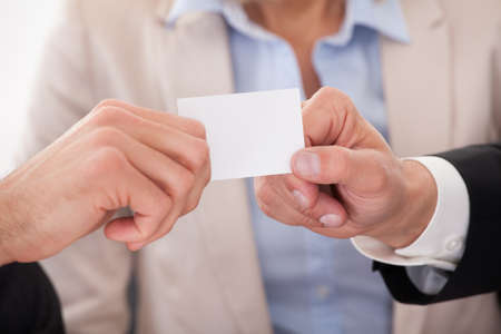 exchanging: Two Businessman Exchanging Visiting Card In front Of Colleges
