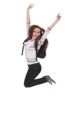 Aufgeregt College Student Springen mit Arme hoch �ber Wei�em Hintergrund Lizenzfreie Bilder