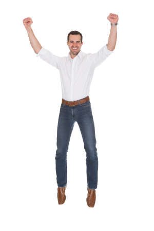 Happy Man With Arm Raised Over White Background Stock Photo - 20508755