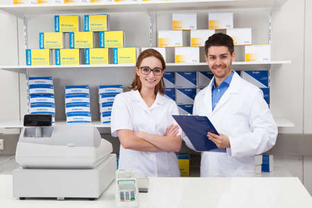 pharmacy store: Portrait Of Two Pharmacist Chemist Working In Pharmacy Stock Photo