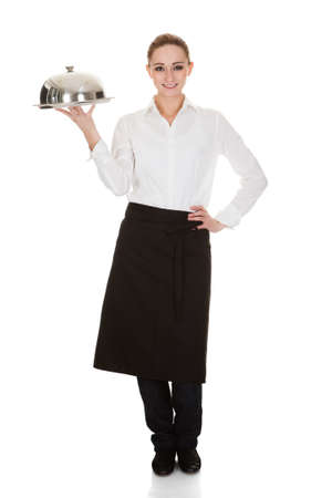 Happy Young Waitress Holding Tray And Lid Over White Background photo