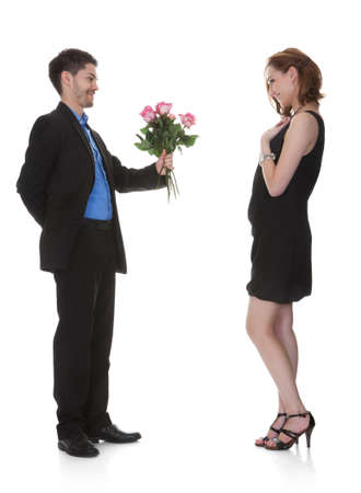 Young Man Offer Flower To Beautiful Woman Over White Background photo