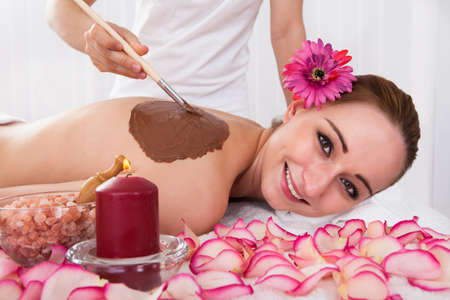 Woman enjoying skin treatment in spa centre photo