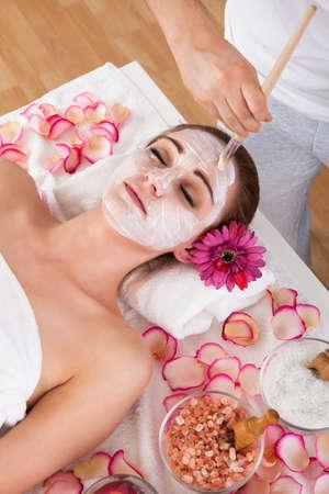 chemical peels: Beautiful young woman getting facial mask at spa studio